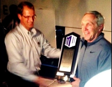 SDSU Coach Rocky Long accepting the Mountain West Conference Championship trophy.