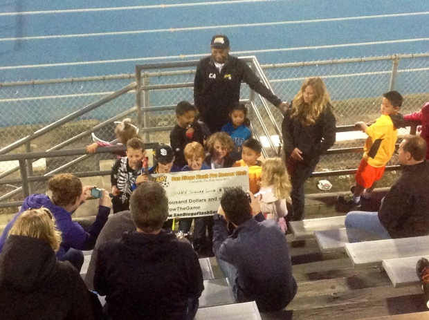 San Diego Flash Presenting the San Diego Surf with a $1,000 check.