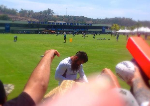 Eric Weddle signing autographs for the fans. Mandatory Photo Credit: David Frerker