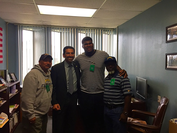 In this photo you have Chargers OT DJ Fluker, Chargers outreach team and the head of San Diego San Diego County's Juvenile Hall.