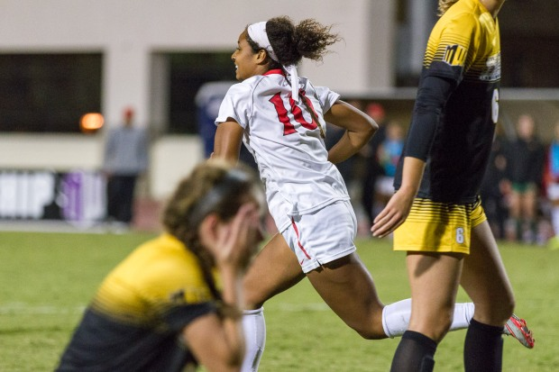 November 5, 2015, San Diego, California, USA: A Colorado College player reacts as San Diego State University's Morgan Darling runs to celebrate the game-winning goal scored by teammate Zsuria Phare, during the second half of the semifinal of the Mountain West Conference's women's soccer championship held in San Diego, California, on November 5, 2015. SDSU would go on to win 2-0 and will play San Jose State in the finals on November 7. Photo credit: Brenda Moffitt