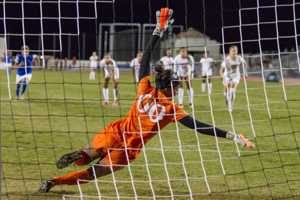 November 7, 2015, San Diego, California, USA: San Diego State University goalkeeper Melanie Vaughn makes a diving attempt to save a San Jose State University penalty kick during the 90th minute of the 2015 Mountain West Conference women's soccer tournament on November 7, 2015 in San Diego, California. The successful penalty kick tied the game 1-1. SJSU went on to win the game in penalty kicks, earning them the Mountain West Conference title and an automatic berth in the NCAA tournament. Photo credit: Brenda Moffitt