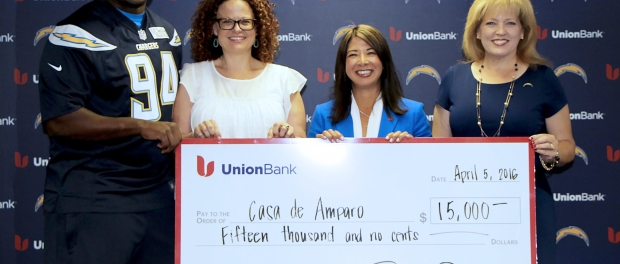 (L to R) San Diego Chargers Defensive End Corey Liuget; Casa de Amparo Executive Director Tamara Fleck-Myers, LMFT; Union Bank Regional President Robbin Narike Preciado; and San Diego Chargers Director of Public Affairs & Corporate/Community Relations Kimberly Layton pause for a photo after Union Bank and the San Diego Chargers presented $15,000 raised through the Game Changers program to Casa de Amparo.